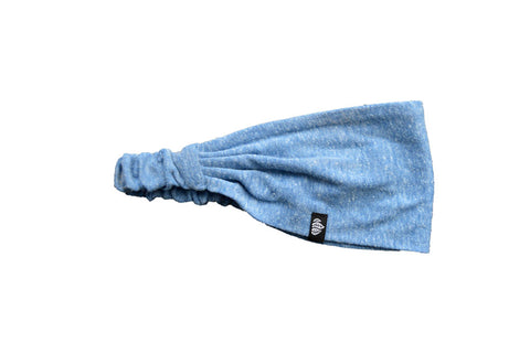 Side view of blue eco headband with trileaf loop tag
