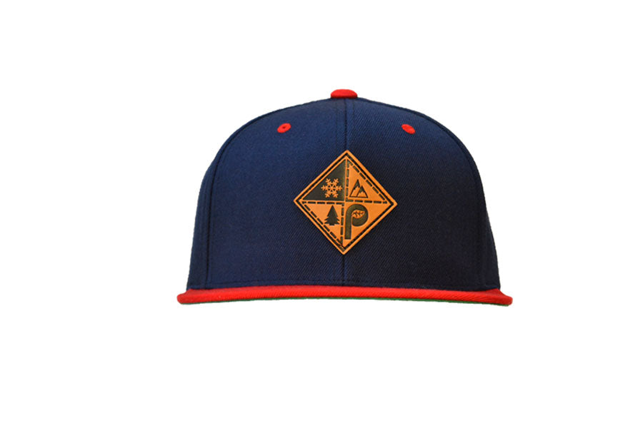 Front view of navy/red pome diamond logo patch snapback