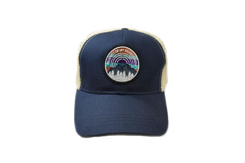 Front view of navy/beige pome circle patch with mountain and tees