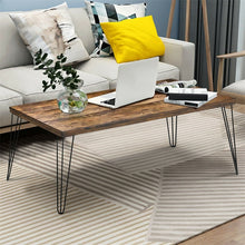 Load image into Gallery viewer, Accent your room with this modern, industrial style solid wood coffee table! This table is both stylish and functional. With sturdy metal legs it offers plenty of space to show off personal photos and decor or even hold your office essentials!