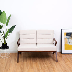 This simple and sophisticated loveseat is the perfect addition to smaller spaces or can be placed in groups to comfortably fill a larger room!