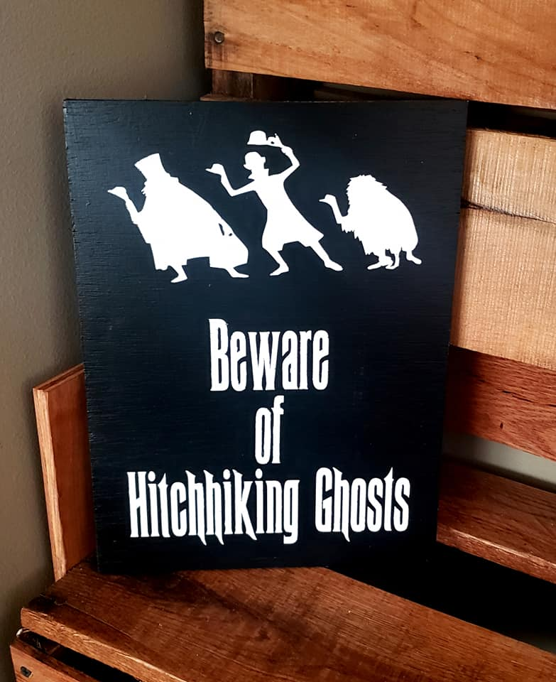 Beware of Hitchhiking Ghosts, haunted mansion sign