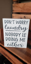 Load image into Gallery viewer, Don't worry laundry nobody is doing me either, laundry room sign, laundry humor