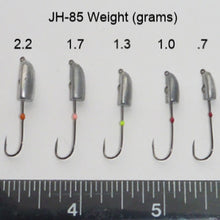 The five weights of JH-85 jig heads. Left to right, 2.2g, 1.7g, 1.3g, 1g, and .7g. Ruler along the bottom showing width of the hook gapes.