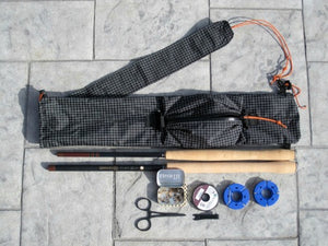 Ebira Plus Rod Quiver, two tenkara rods, two line spools, tippet spool, clamps, nippers and small fly box.