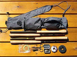 Ebira Guide Rod Quiver, four tenkara rods, line, tippet spool, line holder, clamps, nippers and small fly box.