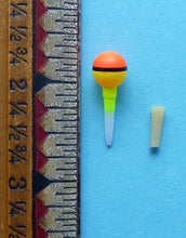 "Nakazima Ball Floats 3/8"" alongside ruler."