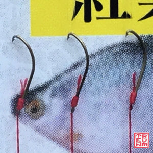 Close-up of Owner Migen Tanago Hooks