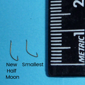 Comparison of Owner New Half Moon and Owner Smallest Tanago Hooks with metric ruler for scale (5 or 6mm long)