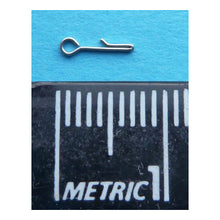 Owner Microfishing Tippet Connector with metric ruler, showing that it is 7mm long.