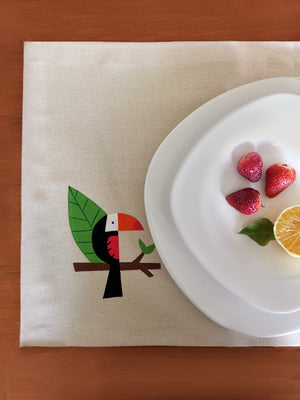 Tucan handpainted placemat served with a healthy breakfast.