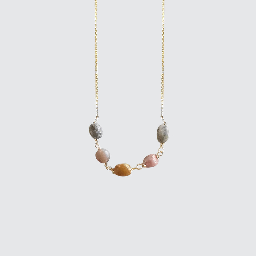 Short golden necklace with five agate stones.