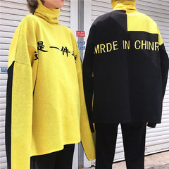 YELLOW BLACK LETTERS PRINT KNIT OVERSIZED HIGH NECK SWEATER