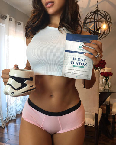 Girl holding 14 day evening cleansing tea