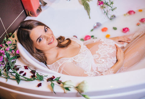 Pregnant women in relaxing bathtub