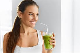 women drinking a glass of Celebrity Detox Tea Fat Burning Matcha Green Tea