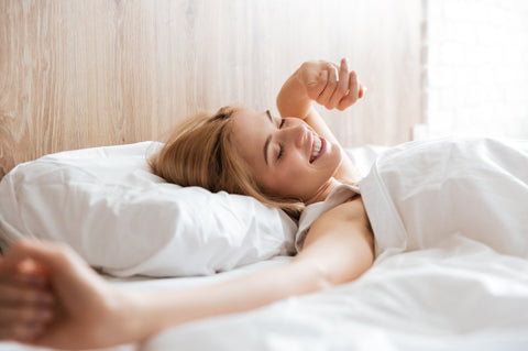 woman in the bed after a good night's sleep
