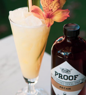 Proof Colada next to a bottle of Pecan Proof Syrup