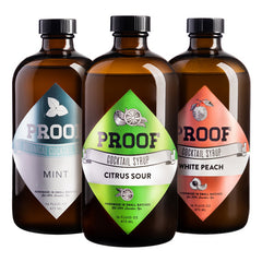 three Proof Syrup bottles: Mint, Citrus Sour, and White Peach