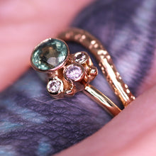Load image into Gallery viewer, Flora ring (modeled side view, pictured with our Arch ring (star-scattered texture, round style band): stunning Songea sapphire (one of a kind) with beautiful rutile and inky inclusions with salt and pepper/gray diamonds (size 5.5 and can be resized complimentary in-house)