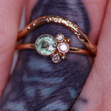 Load image into Gallery viewer, Flora ring (front modeled view, pictured with our Arch ring (star-scattered texture and round style band): stunning Songea sapphire (one of a kind) with beautiful rutile and inky inclusions with salt and pepper/gray diamonds (size 5.5 and can be resized complimentary in-house)