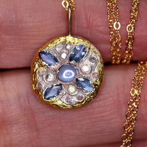 """Ora"": Montana sapphire-encrusted art sculpture pendant (one of a kind)"
