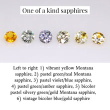 Load image into Gallery viewer, Group photo of the one of a kind sapphires in-stock and available to be made into a Flora design with your choice of 14K gold. From left to right: 1) vibrant yellow Montana sapphire, 2) pastel green/teal Montana sapphire, 3) pastel violet/blue Montana sapphire, 4) pastel green/amber Montana sapphire, 5) bicolor pastel silvery green/gold Montana sapphire, 6) vintage bicolor blue/gold sapphire