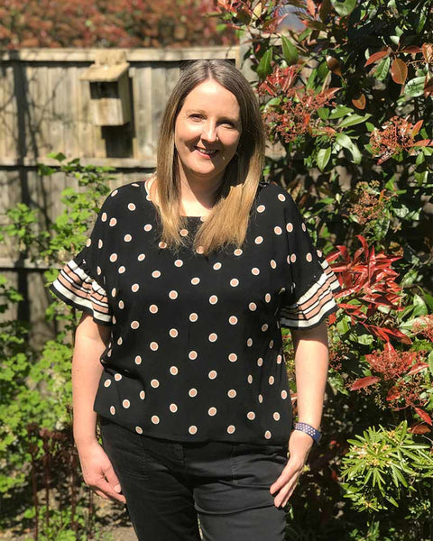 Forget-me-not Lola blouse in black dotted fabric, front view