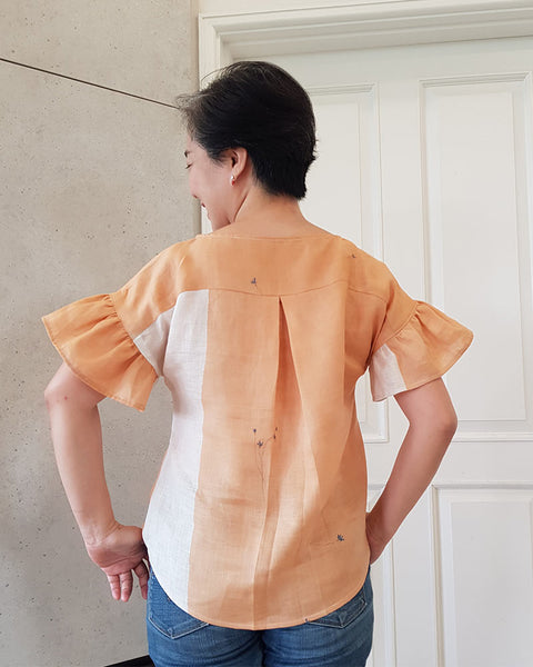 Forget-me-not Lola blouse in apricot linen, back view