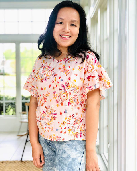 Forget-me-not Lola blouse with ruffle sleeves in floral print, front view