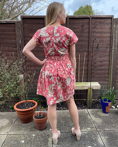 April A-Line dress in pink floral print by Holly - rear view