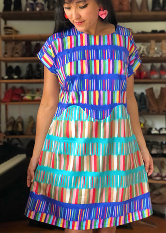 April A-Line dress make in blue and red and aqua pattern by Nadia