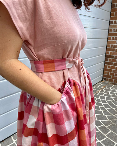 Nicole April A-Line dress and Gemma belt in pink and gingham: pocket detail view