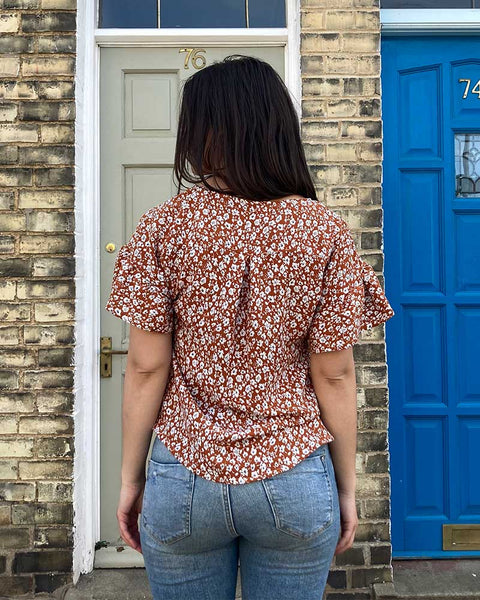 Forget-me-not Lola blouse in red ditsy print, back view