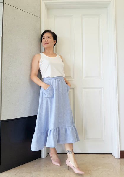 Forget-Me-Not Ella skirt pattern make, by Boon Kuan in bue with rounded patch pockets