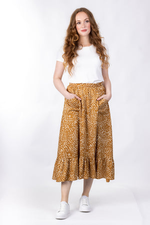 Forget-Me-Not Ella long skirt pattern in mustard, full-length front shot of model highlighting pockets
