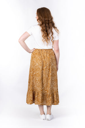Forget-Me-Not Ella long skirt pattern in mustard, full-length rear shot of model
