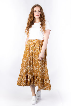 Forget-Me-Not Ella long skirt pattern in mustard, full-length front shot of model