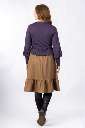 Forget-Me-Not Ella knee length skirt pattern in brown, full-length rear shot of model