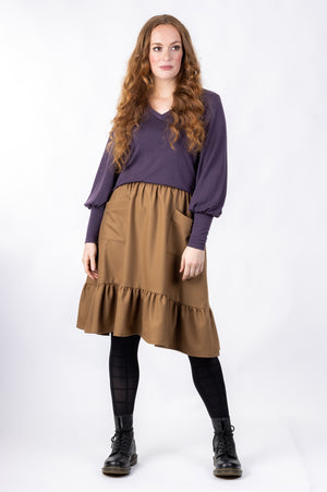 Forget-Me-Not Ella knee length skirt with pockets pattern in brown, full-length front shot of model