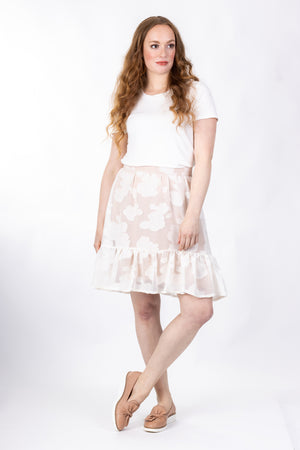 Forget-Me-Not Ella short skirt pattern in cream floral, full-length front shot of model