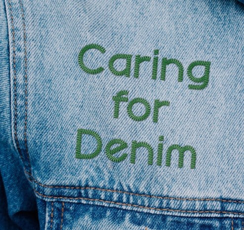 Caring for denim embroidered message on denim garment.