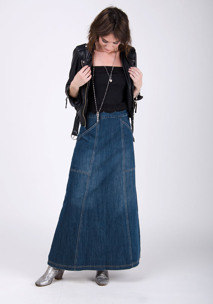 Long denim skirt paired with silver boots and black top.