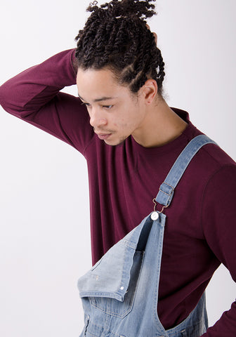 Mens dungarees styled with one strap undone.