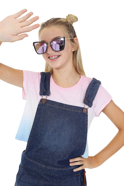 Wearing denim bib overall dress and 2-tone t-shirt with pink mirror shades.