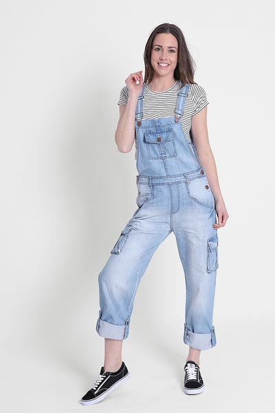 'Daisy' brand pale denim cargo pocket dungarees with turn-ups on legs, paired with hooped t-shirt.