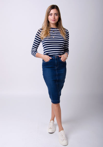 Denim knee-length skirt paired with hooped black and white sweater.