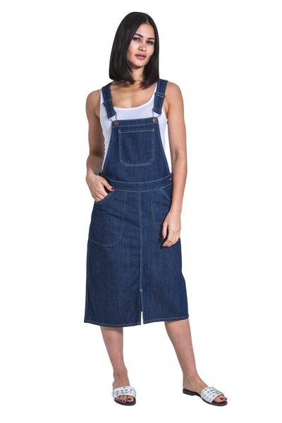 Indigo dungaree dress with hand in front-right pocket,