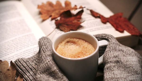 Hot coffee with a snuggly jumper and a good book.