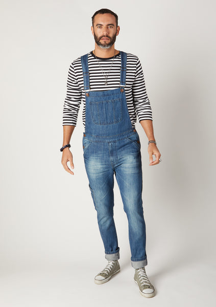 Denim Dungarees for men paired with hooped t-shirt.